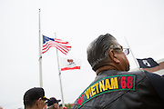 Jose Villagomez, United States Marine Corps ('1966-1972), wears a leather vest with the dates of service during the Vietnam War during the Milpitas Memorial Day Ceremony at Veterans Memorial Flag Plaza in Milpitas, California, on May 27, 2013. (Stan Olszewski/SOSKIphoto)