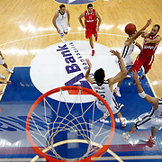 Anadolu Efes's (L-R) Jordan Farmar, Semih Erden, Kerem Tunceri, sasha vujacic, Kerem Tunceri and Olympiacos's Vassilis Spanoulis (R) during their Turkish Airlines Euroleague Basketball Group C Game 2 match Anadolu Efes between Olympiacos at Abdi ipekci Arena in Istanbul, Turkey, Friday, October 19, 2012. Photo by TURKPIX