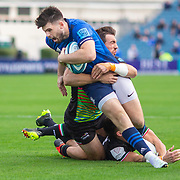 DUBLIN, IRELAND:  October 9:   Harry Byrne #10 of Leinster is tackled by Enrico Lucchin #12 of Zebre and Erich Cronjé #13 of Zebre during the Leinster V Zebre, United Rugby Championship match at RDS Arena on October 9th, 2021 in Dublin, Ireland. (Photo by Tim Clayton/Corbis via Getty Images)