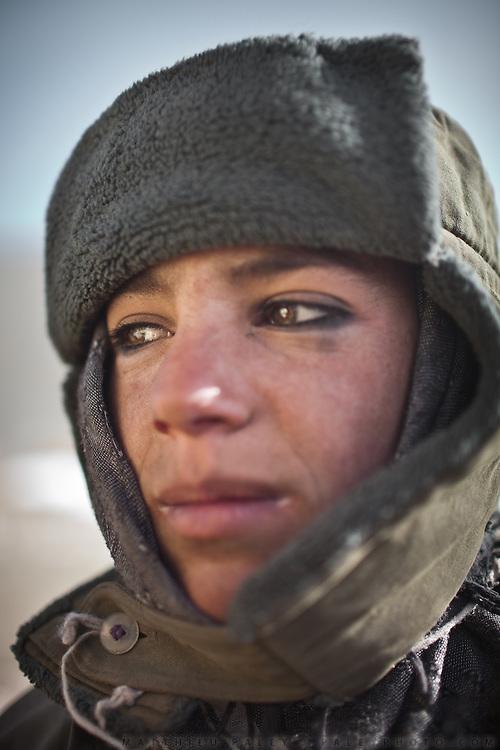 A young Wakhi Shepherd. Trekking up to the Little Pamir with yak caravan over the frozen Wakhan river.