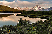 Mount Moran and the Grand Teton mountains at Oxbow Bend reflected at dawn on the Snake River at the Grand Teton National Park in Moran, Wyoming.