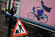 Barclays bike service van and street roadworks sign