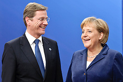 Germany's Federal Chancellor Angela Merkel and German Foreign Minister Guido Westerwelle (L) during arrivals for an EU summit in Brussels, Belgium on 2009-10-29 EU leaders open a difficult summit, facing an east-west rift over who should pay most to entice developing nations to sign up to a new global climate change pact. EXPA Pictures © 2016, PhotoCredit: EXPA/ Photoshot/ Wiktor Dabkowski<br /> <br /> *****ATTENTION - for AUT, SLO, CRO, SRB, BIH, MAZ, SUI only*****
