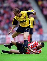 Ray Parlour (Arsenal) tackled by Paul Thirlwell (Sunderland). Sunderland 1:0 Arsenal. FA Premiership,19/8/2000. Credit Colorsport / Stuart MacFarlane.