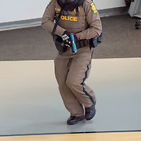A Navajo Nation police officer makes her way through the court of the fitness center at the Tséhootsooí Medical Center, as part of the active shooter training exercise, in Window Rock on Thursday.