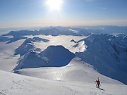 A ski mountaineer ascends the upper reaches of Mount Marcus Baker, the highest peak in the Chugach mountains, in the winter.