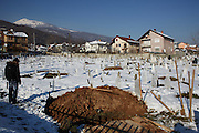 MACEDONIA January 2016. A man waits for a funeral procession at the Albanian cemetery.