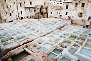 Tanning and lime pits at a leather tannery in Fes El-Bali, Morocco on October 31, 2007. The tanneries are set within the tightly packed buildings of the Medieval city and have not changed for centuries.
