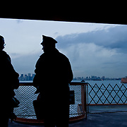 Cops looking to Manhattan, seen from the Staten Island Ferry.