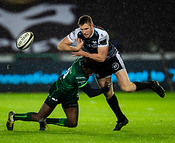 Tiaan Thomas-Wheeler of Ospreys is tackled by Niyi Adeolokun of Connacht<br /> <br /> Photographer Simon King/Replay Images<br /> <br /> Guinness PRO14 Round 6 - Ospreys v Connacht - Saturday 2nd November 2019 - Liberty Stadium - Swansea<br /> <br /> World Copyright © Replay Images . All rights reserved. info@replayimages.co.uk - http://replayimages.co.uk