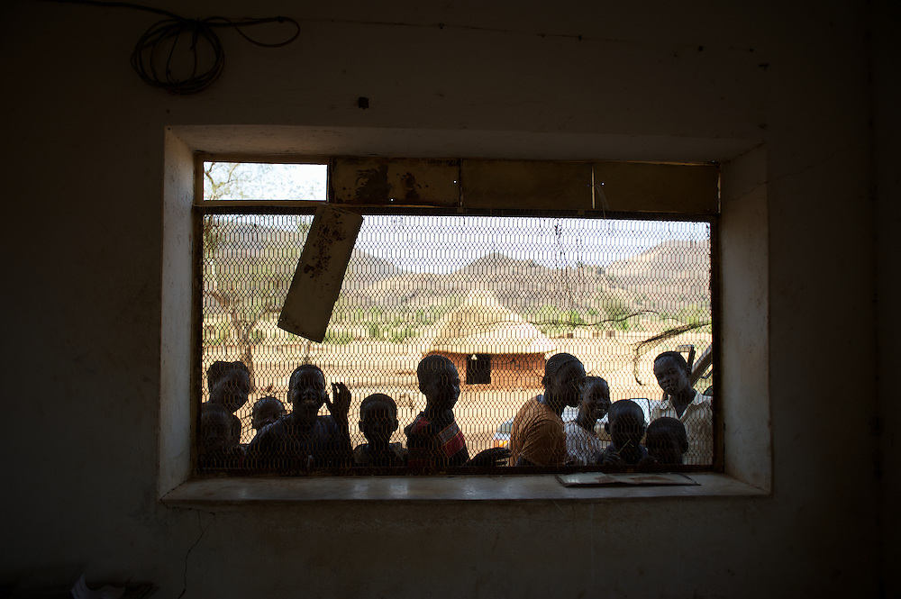 May 01, 2012 - Kauda, Nuba Mountains, South Kordofan, Sudan: A group of children look through a window at Gigeba Clinic, a medical facility used by Sudan People?s Liberation Movement (SPLA-N) to treat their rebel soldiers injured in combat against Sudan's Armed Forces (SAF) in the rebel-held territory of the Nuba Mountains in South Kordofan...SPLA-North, a historical ally of SPLA, South Sudan's former rebel forces, has since last June being fighting the Sudanese Army Forces (SAF) over the right to autonomy and of the end of persecution of Nuba people by the regime of President Bashir. (Paulo Nunes dos Santos/Polaris)