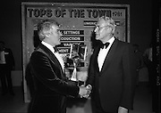 """Tops of the Town Final.   (N79)..1981..31.05.1981..05.31.1981..31st May 1981..The John Player sponsored Tops Of The Town competition had its final tonight in the Gaiety Theatre, Dublin.The overall winners were the Limerick Insurances Group..Image shows Mr Harry Nolan (L), Group leader of the Irish Biscuits show, (Semi Finalist in """"Tops"""") and Mr Oliver Casey , Managing Director, John Player."""
