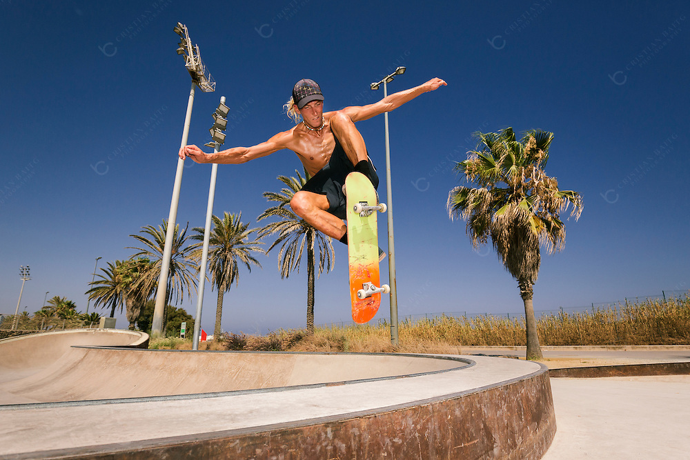 Young man jumping with skateboard