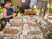 05 OCTOBER 2012 - BANGKOK, THAILAND: A man buys dried squid in a market in the Chinatown section of Bangkok, Thailand.       PHOTO BY JACK KURTZ