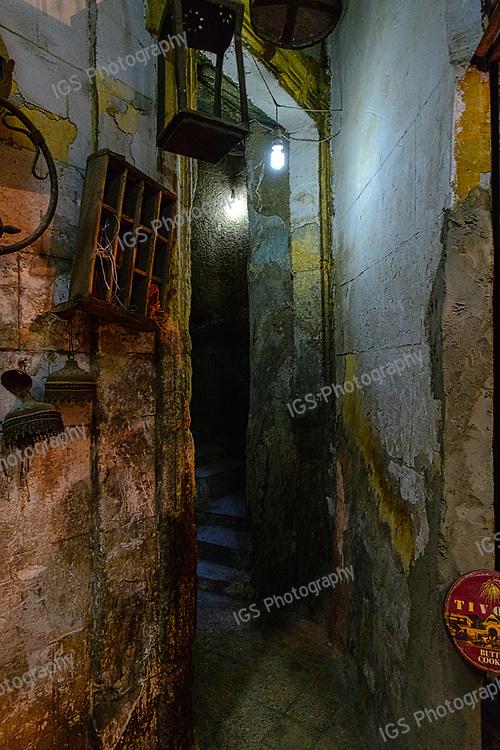 Dimly lit alleyway in Khan El Khalili market