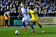Michael Kelly (28) of Bristol Rovers being pressurised by Deji Oshilaja (4) of AFC Wimbledon during the EFL Sky Bet League 1 match between Bristol Rovers and AFC Wimbledon at the Memorial Stadium, Bristol, England on 23 October 2018.