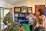 Seaford, New York, U.S. 20th July 2013. At left, KOREY LARSON, 1st Lieut. of Air National Guard, is speaking with children and their parents at Science Exploration Moon Day, presented by Long Island Fringe Festival 5, which was hosted by Tackapausha Museum and Preserve. Lt. Larson is from Seaford and iswith the 106 Rescue Wing, stationed in West Hampton Beach.