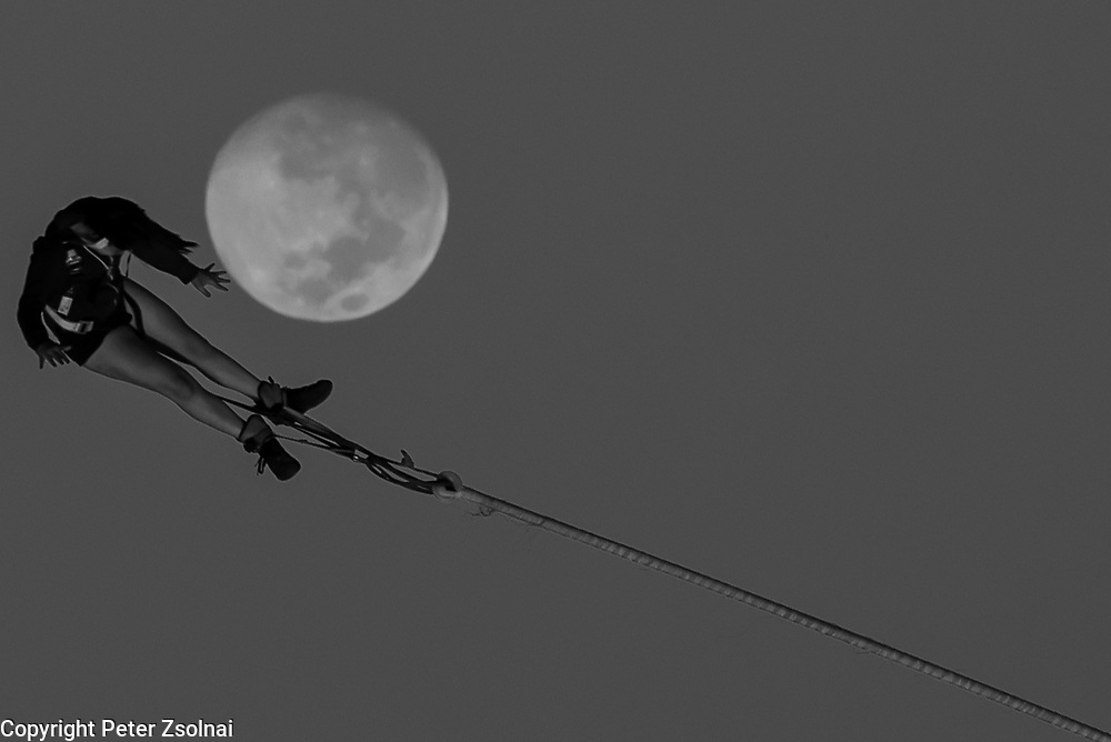 A person is bungeeing to the moon on the Sound Festival in Zamardi in Hungary.