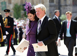 Earl Spencer and Karen Spencer leave St George's Chapel at Windsor Castle after the wedding of Meghan Markle and Prince Harry.