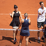 PARIS, FRANCE June 10. Desirae Krawczyk of the United States and Joe Salisbury of Great Britain celebrate after winning the mixed doubles final are congratulated by Elena Vesnina and Aslan Karatsev of Russia on Court Philippe-Chatrier during the 2021 French Open Tennis Tournament at Roland Garros on June 10th 2021 in Paris, France. (Photo by Tim Clayton/Corbis via Getty Images)