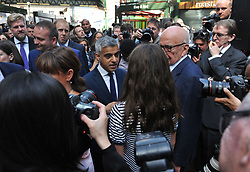 Mayor of London Sadiq Khan speaks to Rupert Murdoch as they view market stalls in Borough Market which has opened for the first time since the London Bridge terrorist attack.