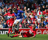 Photo: Andrew Unwin.<br />Middlesbrough v Everton. The Barclays Premiership. 29/04/2006.<br />Middlesbrough's Ray Parlour (R) slides in to tackle Everton's James Beattie.