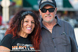 Viv and Neal Brumby of Heavy Duty Magazine (Australia) on Main Street in Sturgis during the 75th Annual Sturgis Black Hills Motorcycle Rally.  SD, USA.  August 3, 2015.  Photography ©2015 Michael Lichter.