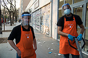 """April, 10th 2020 - Paris, Ile-de-France, France: Supermarket workers wearing a range of masks and facial coverings in the hope of protecting themselves from the spread of the Coronavirus, during the end of the first month of near total lockdown imposed in France. A week after President of France, Emmanuel Macron, said the citizens must stay at home for at least 15 days, that has been extended. He said """"We are at war, a public health war, certainly but we are at war, against an invisible and elusive enemy"""". All journeys outside the home unless justified for essential professional or health reasons are outlawed. Anyone flouting the new regulations is fined. Nigel Dickinson"""