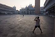 Early morning people in Piazza San Marco, Venice, Italy.