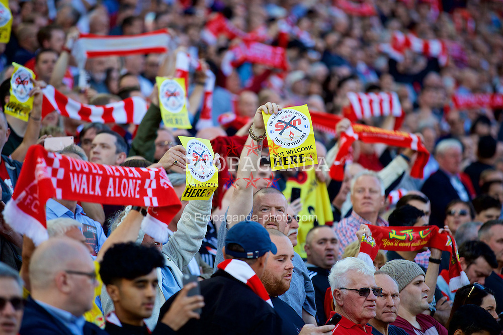 LIVERPOOL, ENGLAND - Saturday, September 10, 2016: A Liverpool supporter with a Shun the Sun leaflet during the FA Premier League match against Leicester City at Anfield. (Pic by David Rawcliffe/Propaganda)