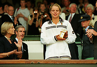 Tennis - 1998 Wimbledon Championships - Girls Singles final - Katarina Srebotnik v Kim Clijsters  04/07/1998<br /> <br /> Kim Clijsters of Belgium with her runners up clock presented in The Rpyal box on Centre court<br /> <br /> Katarina Srebotnik defeated Kim Clijsters in the final, 7–6(7–3), 6–3 to win the Girls' Singles tennis