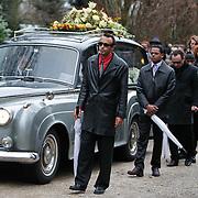NLD/Amsterdam/20110108 - Uitvaart Boney M zanger Bobby Farrell, rouwauto met vooraan zonen