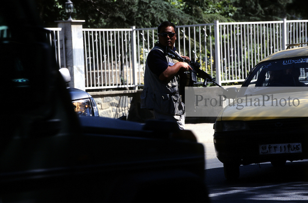 Kabul, 23 July 2005..A soldier stop the traffic to let his main car to pass by.