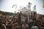 Glastonbury Festival on June 27th 2019 in Glastonbury, Somerset, United Kingdom. People lined up in the symbol of Extinction Rebellion waite and wave to the helicopter to be photographed. <br /> The festival has been going for decades and this year the sun is beating down promising a dry weekend.