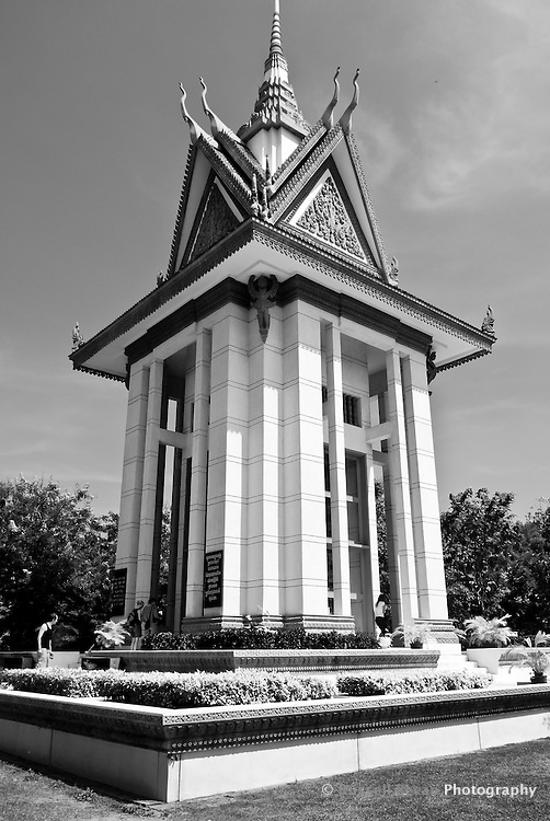 The commemorative stupa filled with the skulls & bones of victims of the Khmer Rouge at Choeung Ek, 17 km South of Phnom Penh, Cambodia
