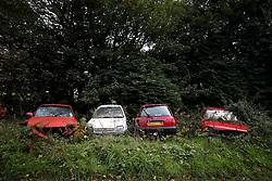 Abandoned cars in the Dyfi Forest during day three of the DayInsure Wales Rally GB
