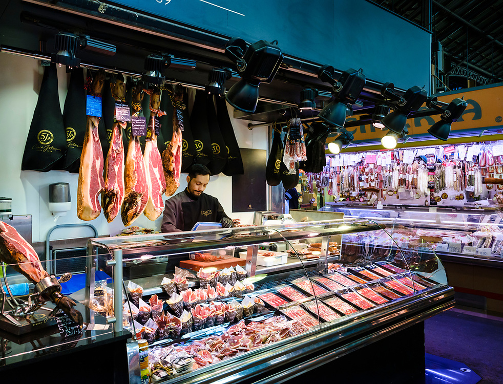 BARCELONA, SPAIN - CIRCA MAY 2018: Merchant in La Boqueria. This is a large public market in the Ciudad Vieja district of Barcelona, Catalonia, Spain, and one of the city's foremost tourist landmarks.