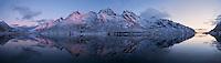 Soft twilight glow of December Mørketid - Polar Night in Skjelfjord, Flakstadøy, Lofoten Islands, Norway