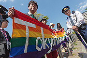 The start of the parade at the Rainbow Pride Event in Yoyogi Park, Shibuya, Tokyo, Japan. Sunday, April 26th 2015. This is the forth annual celebration of LGBT issues in Tokyo and forms part of a wider Rainbow Week. About 5% of the Japanese population identify as homosexual and this event hopes to foster a society where they can live equally and without prejudice.