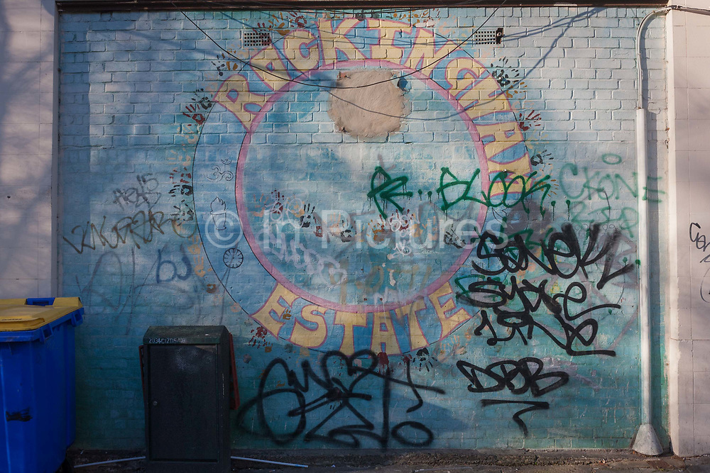 Graffiti on a wall in the Rockingham Estate, on 28th November 2016, in the south London borough of Southwark, England. Graffiti has been sprayed on the brickwaork where the mural has been painted near a junction and on the wall of a corner community shop. Rockingham is located in south London near the Elephant and Castle. Notorious for youth issues including gangs and knife crime where 12-year-olds are seen holding knives in broad daylight.