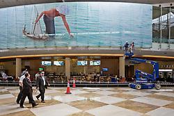 Businessmen walking through a Dubai mall