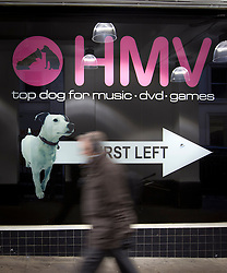 © Licensed to London News Pictures. 20/02/2013. London, UK. A commuter walks past the Trocadero branch of struggling music, DVD and games retailer HMV in London today (20/02/2013). The branch is one of 66 HMV scheduled for closure, with the loss of 930 jobs across the country, after the company's administrators Deloitte admitted they would not be seeking a buyer for the entire business.   Photo credit: Matt Cetti-Roberts/LNP