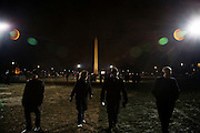 Obama Inauguration - Monday activities around the Capitol on Martin Luther King Jr. Day. Crowds wander around the Mall at nightfall on the eve of Obama's inauguration.