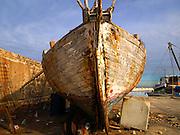 Israel, Tel Aviv-Jaffa, Old dilapidated boat at dry dock at the Jaffa port