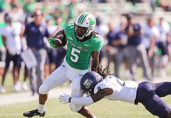 Oct 9, 2021; Huntington, West Virginia, USA; Marshall Thundering Herd running back Sheldon Evans (5) runs the ball and shakes a tackle from Old Dominion Monarchs safety R'Tarriun Johnson (21) during the second quarter at Joan C. Edwards Stadium. Mandatory Credit: Ben Queen-USA TODAY Sports