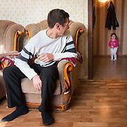 CAPTION: Stella's father Arman plays with his elder daughter, Safira. LOCATION: Volgograd, Russia. INDIVIDUAL(S) PHOTOGRAPHED: Arman Aharonyan (left) and Safira Aharonyan (right).