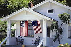 House With 2 American Flags