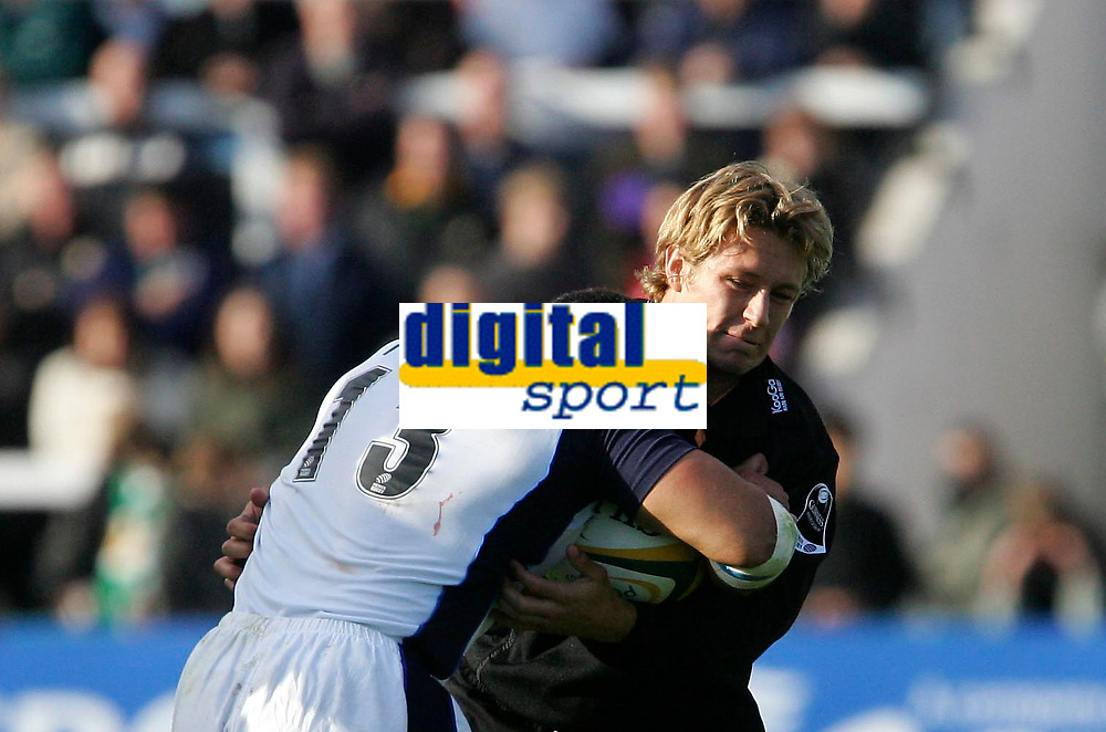 Photo: Andrew Unwin.<br /> Newcastle Falcons v Sale Sharks. Powergen Cup.<br /> 02/10/2005.<br /> Sale's Elvis Sevalai'l (L) is tackled by Newcastle's Jonny Wilkinson (R).