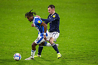 Huddersfield Town's Rolando Aarons shields the ball from Millwall's Jed Wallace<br /> <br /> Photographer Alex Dodd/CameraSport<br /> <br /> The EFL Sky Bet Championship - Huddersfield Town v Millwall - Wednesday 20th January 2021 - The John Smith's Stadium - Huddersfield<br /> <br /> World Copyright © 2021 CameraSport. All rights reserved. 43 Linden Ave. Countesthorpe. Leicester. England. LE8 5PG - Tel: +44 (0) 116 277 4147 - admin@camerasport.com - www.camerasport.com