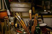 Artist's paint brushes in container on a worktable